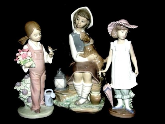 Two LLadro Girl And One Nao Figurines