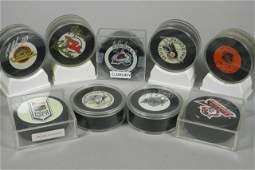 Nine Miscellaneous Signed Hockey Pucks