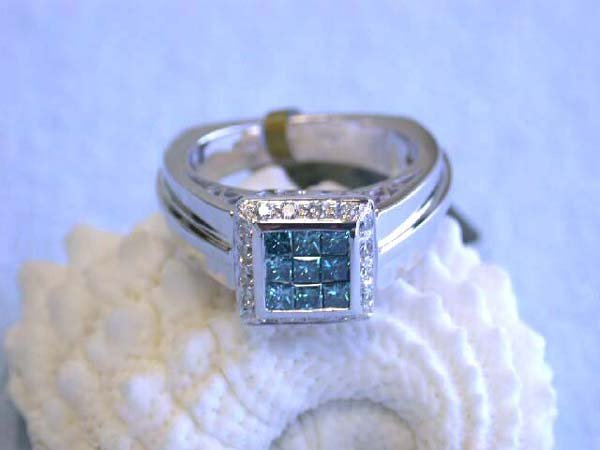 504: 18K White Gold Ring with Round and Blue Diamonds