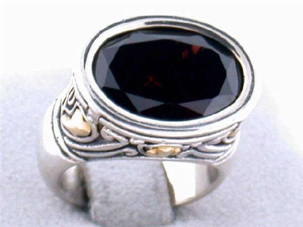 Silver and Gold Ring with Garnet