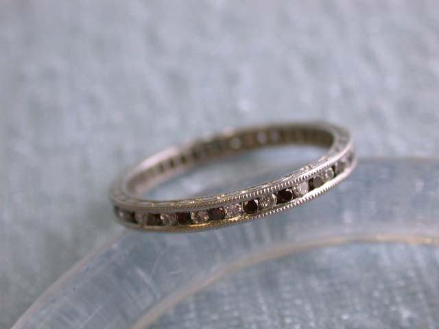 Platinum Ring with Diamonds and Garnet