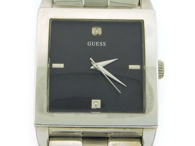 4: Guess Stainless Steel Dress Watch