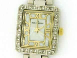 AK Anne Klein Women's Silver and Gold tone Watch wi