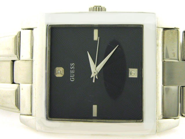 99A: Guess Stainless Steel Dress Watch