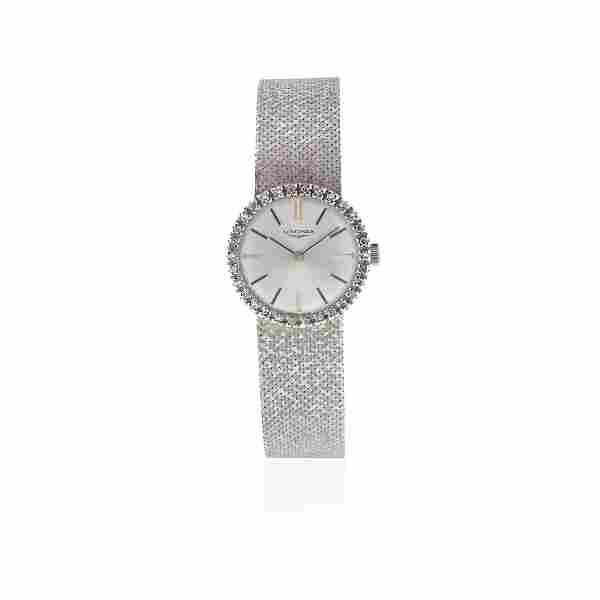 Longines. A lady's 18K white gold and diamond set
