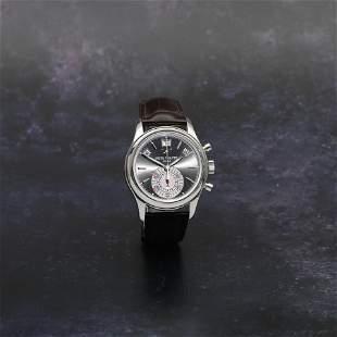Patek Philippe. A fine platinum automatic annual