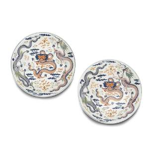 A pair of large famille rose enameled dragon dishes