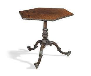 A George III mahogany tripod table of 'English Rococo'