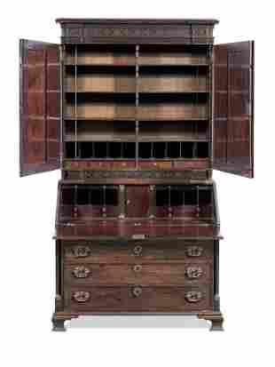 A George III carved mahogany and ormolu mounted bureau
