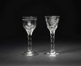 An engraved 'Thistle Club' wine glass and another of