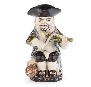 An important Staffordshire 'Fiddler' Toby Jug, dated