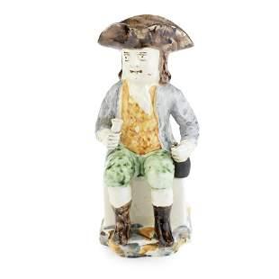 A Portuguese creamware 'Sailor' Toby jug, circa 1800