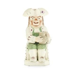A creamware 'Ruddy-Faced' Toby Jug, circa 1810-20