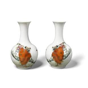 A pair of famille rose vases depicting an arhat