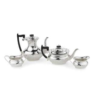 A silver four-piece tea and coffee service