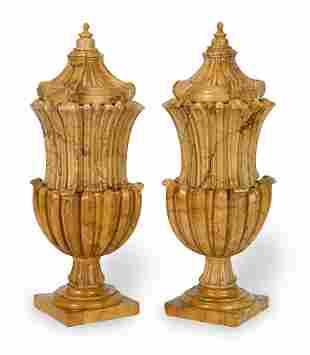 A PAIR OF ITALIAN CARVED SIENA MARBLE URNS AND COVERS