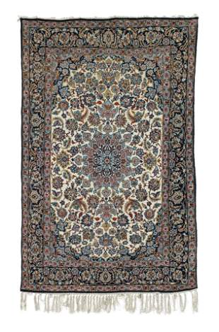 A LARGE CREAM GROUND NIAN MEDALLION CARPET AND A