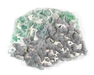 A VERY LARGE GREEN AND PURPLE FLUORITE ON QUARTZ