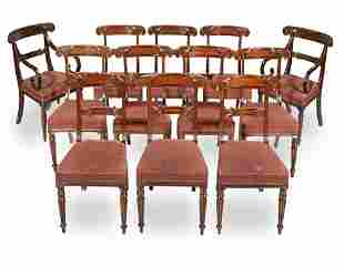 A SET OF EIGHTEEN MAHOGANY AND EBONISED DINING CHAIRS