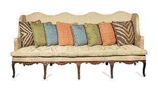 A LARGE FRENCH CARVED STAINED BEECH CANAPE OR SOFA