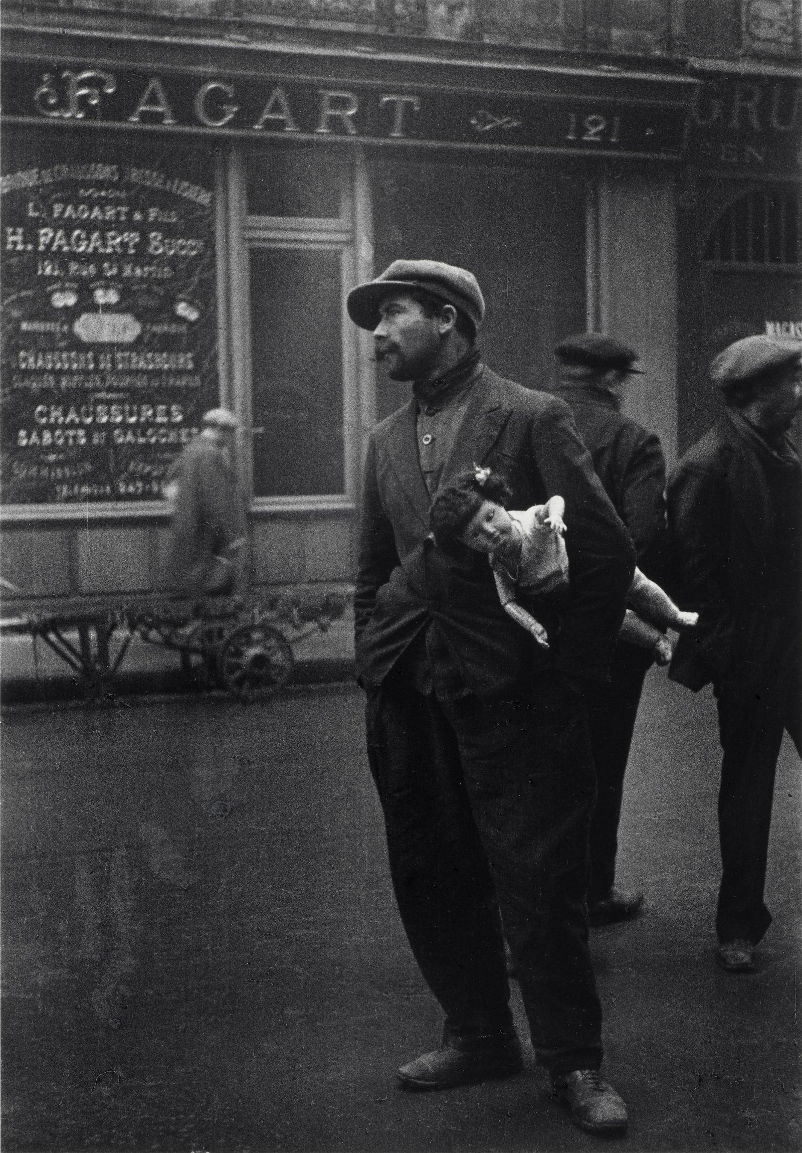 Alfred Eisenstaedt (1898-1995); Man with Doll near Rue