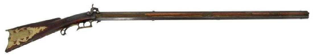 Over & Under Rotating Barrel Percussion Rifle