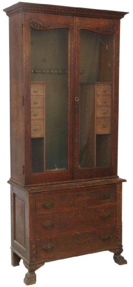 The Holt Carved Oak Step Back 2 Dr. Gun Cabinet