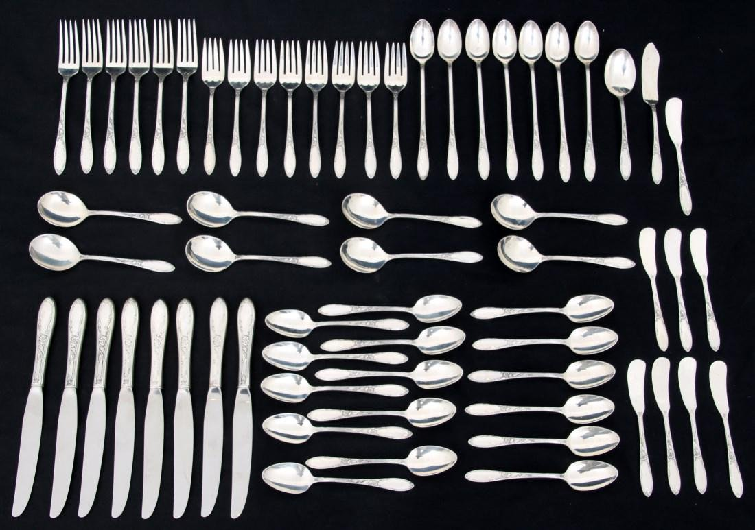63 Pcs. Oneida Sterling Silver Flatware