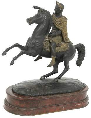 Bronze Sculpture of a Man on Horseback