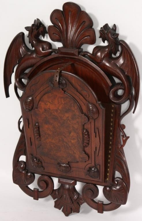 114: Walnut Renaissance Revival Carved Magazine Rack.