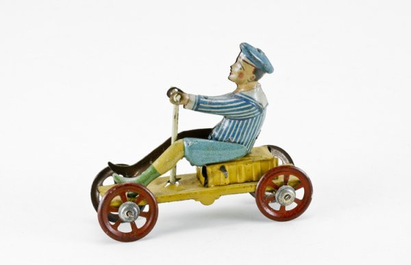 12: German Mechanical Boy on Cart Penny Toy