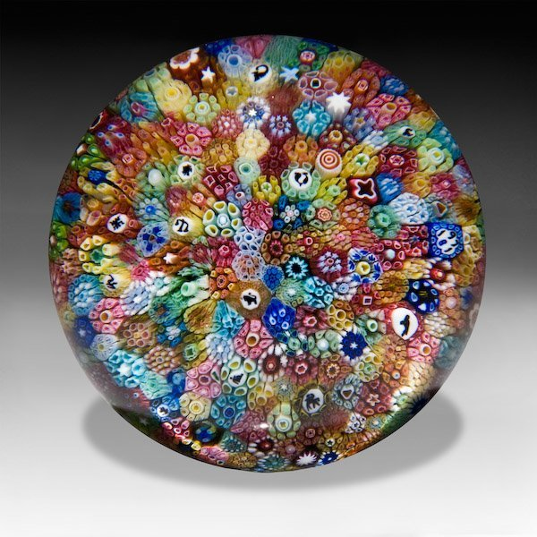 11: Baccarat 1971 close packed millefiori paperweight..