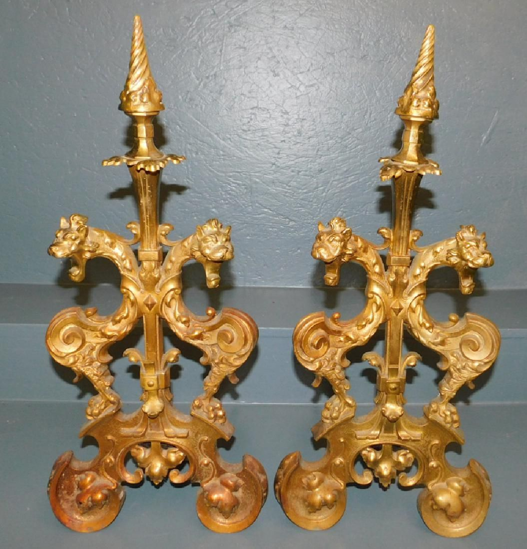 Pair of heavy brass gargoyle andirons.