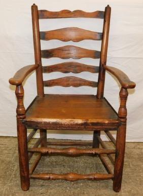 18th C ladder back arm chair.