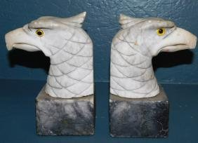 Pair of marble eagle head bookends w glass eyes.