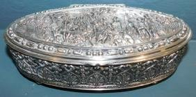 "Silver plate Oval figural dresser box. 9"" long."