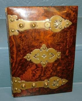 Burl walnut and brass bound bookplate.