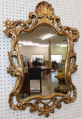 "Gold leaf French style mirror. 34"" x 21""."