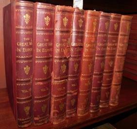Set of 8 English quarter leather bound books.