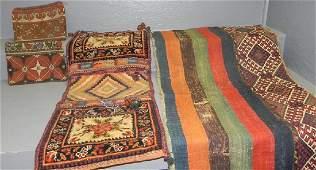 Camel Saddle bag and 4 rug remnants.