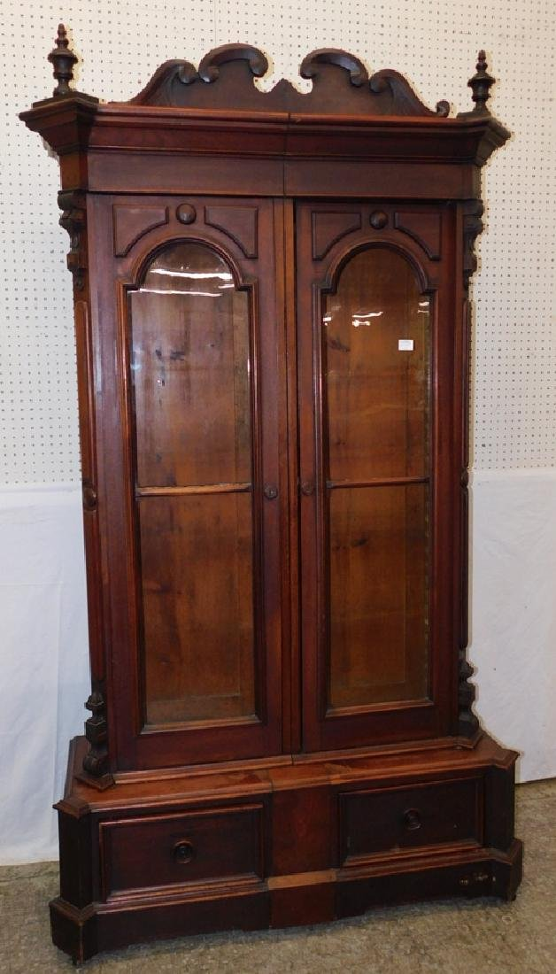 2 door American Vict walnut step back bookcase.