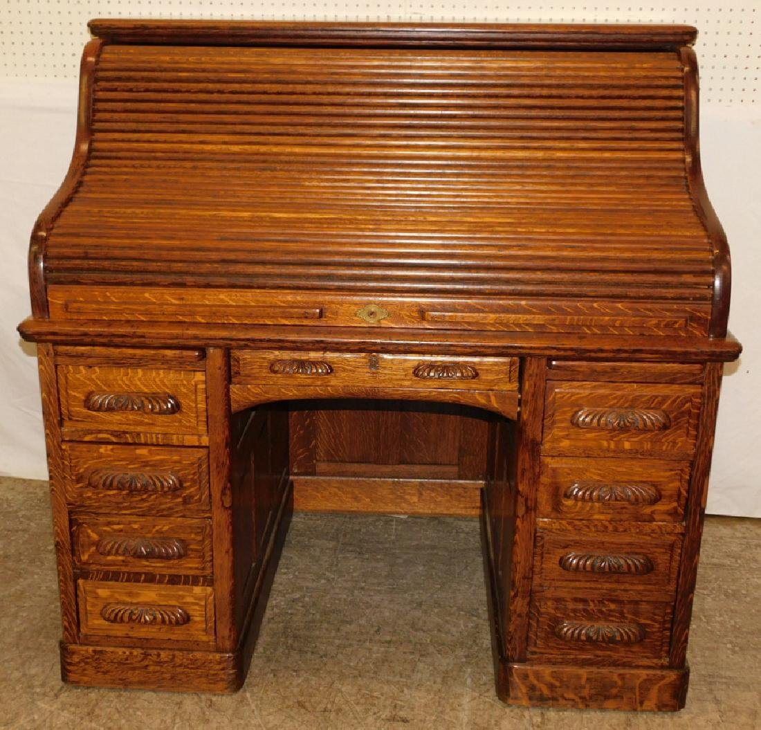 American oak S-roll top desk w carved handles