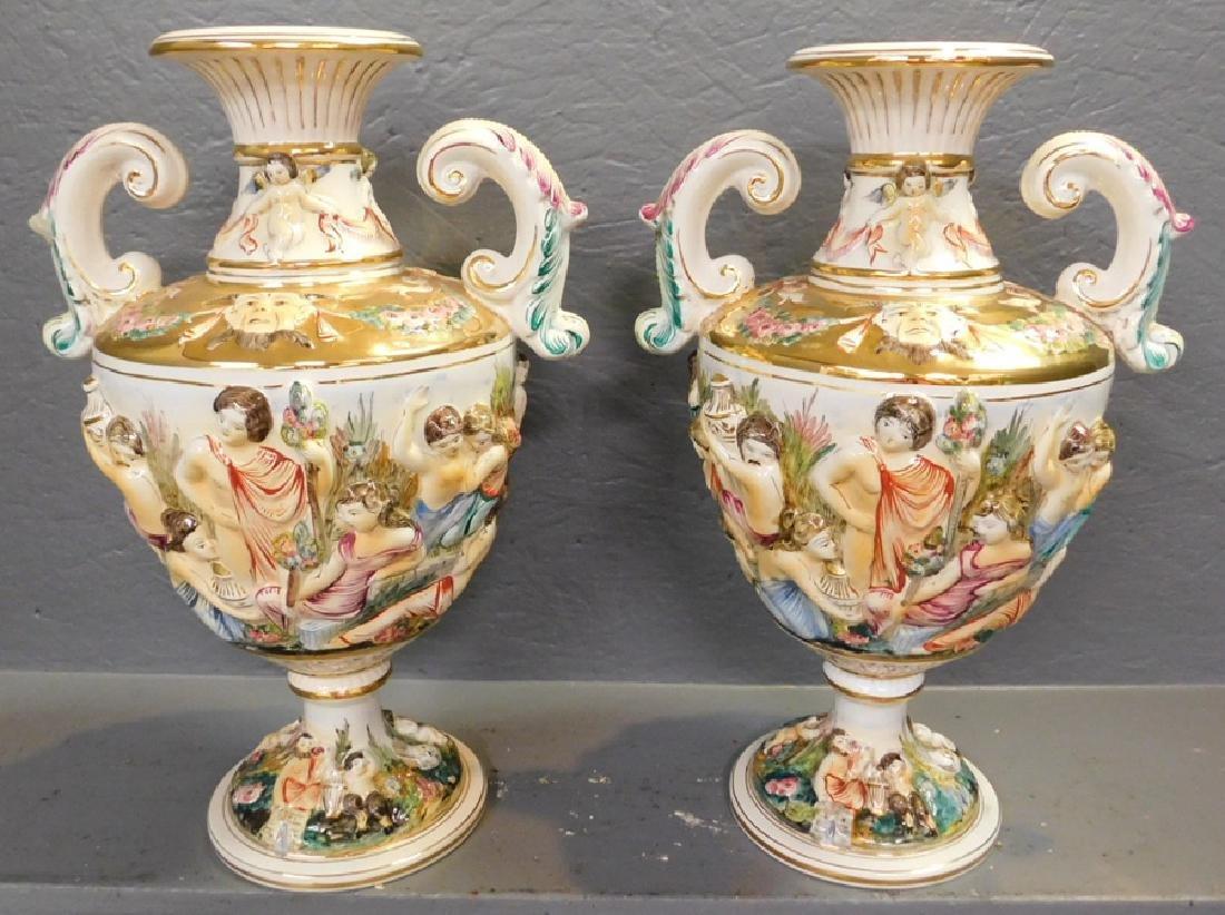 "Pair of Italian Capodimonte vases. 17"" tall."