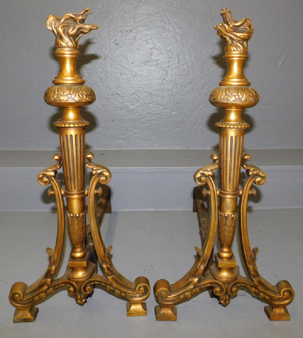 """Pair of flame top brass andirons. 22"""" tall."""