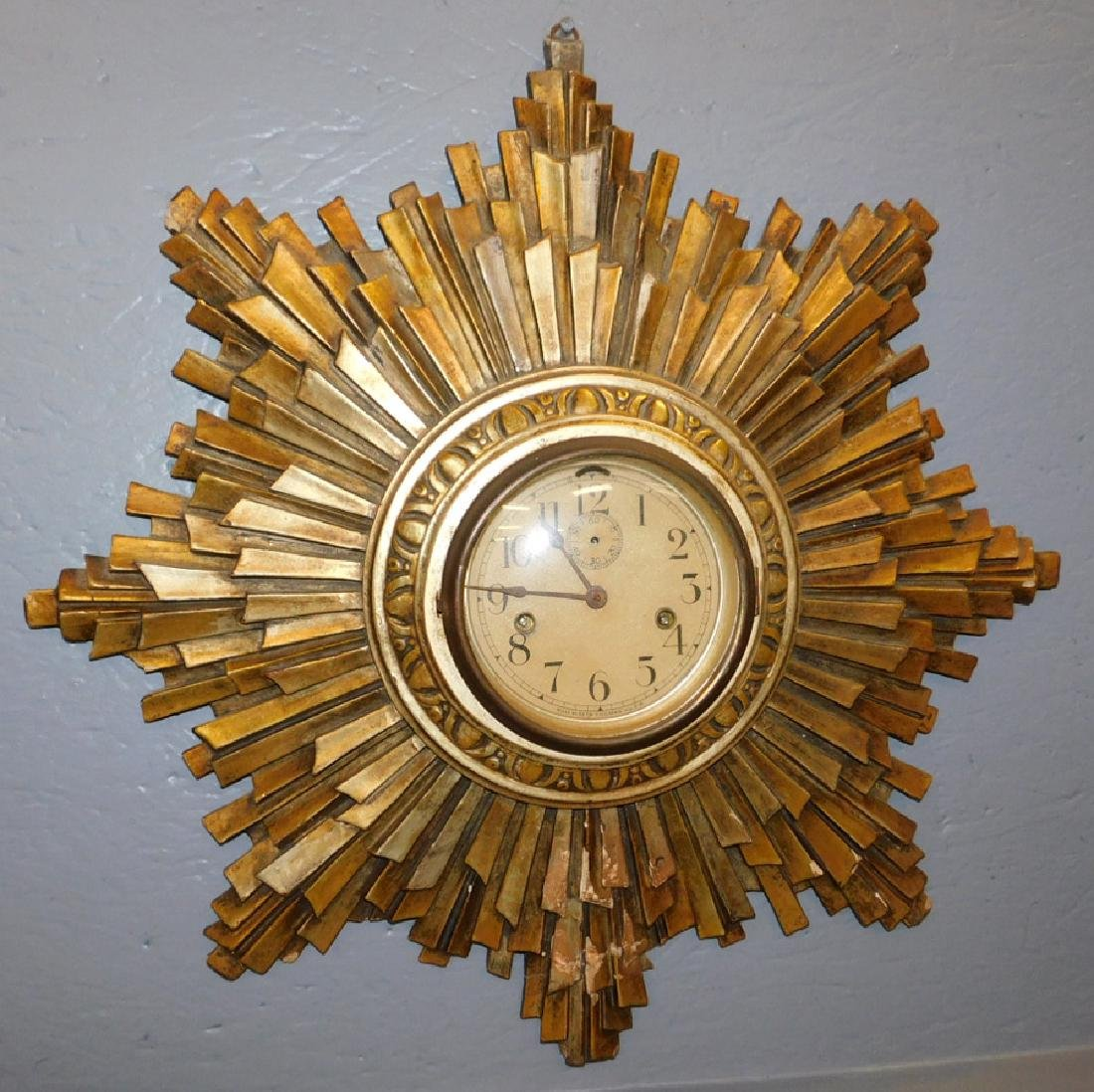 Seth Thomas gesso framed sunburst wall clock.