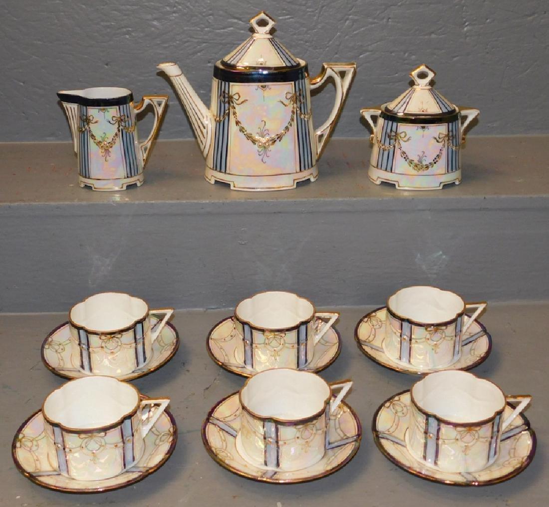 9 pc porcelain tea set.