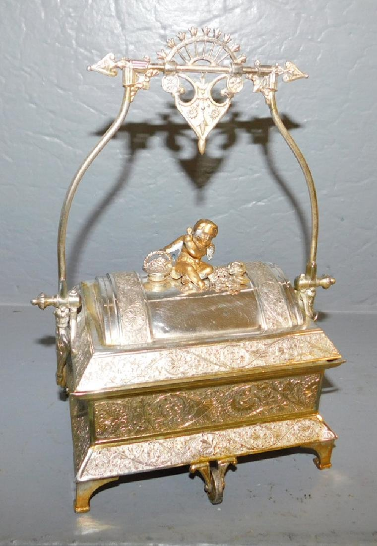 Meridian silver plated mechanical covered box.