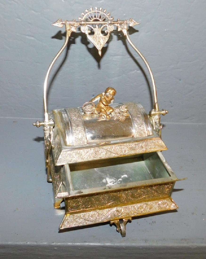 Meridian silver plated mechanical covered box. - 2