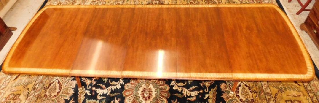 Banded top double pedestal table with 3 leaves.