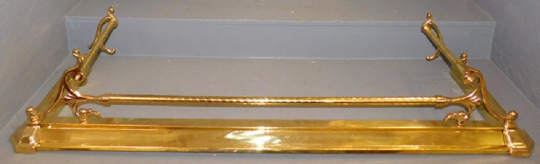 """Brass fire fender. 52"""" long."""
